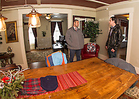 Officer Eric Adams gets a tour of Riverbank's Launch House with Dan Farrell during the Open House on Friday afternoon.   (Karen Bobotas/for the Laconia Daily Sun)