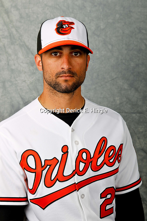 March 1, 2012; Sarasota, FL, USA; Baltimore Orioles right fielder Nick Markakis (21) poses for a portrait during photo day at the spring training headquarters.  Mandatory Credit: Derick E. Hingle-US PRESSWIRE