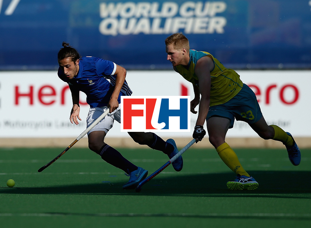 JOHANNESBURG, SOUTH AFRICA - JULY 11: Daniel Beale of Australia and Charles Masson of France battle for possession during day 2 of the FIH Hockey World League Semi Finals Pool A match between Australia and France at Wits University on July 11, 2017 in Johannesburg, South Africa. (Photo by Jan Kruger/Getty Images for FIH)