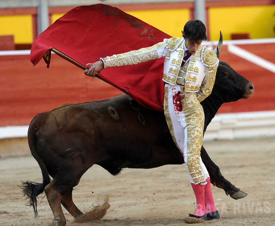 Spanish matador Antonio Nazare performs a pass with muleta to his Cebada Gago bull during the third corrida of the San Fermin Festival, on July 9, 2012,  in the Northern Spanish city of Pamplona. PHOTO / Rafa Rivas