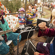 "Musicians perform on a rolling truck at the Courier de Mardi Gras in Eunice, Louisiana. The Courier de Mardi Gras in Eunice is a 15-mile music and dance filled 'run' through the rural bayou-land with costumed revelers play-acting at begging (rooted in the fête de la quémande (""feast of begging"") of Medieval France) and chasing chickens in order to collect the ingredients for the communal gumbo. The event is celebrated in Cajun communities in Louisiana on final day before Lent."