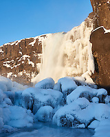 Öxaráfoss waterfall at sunrise in winter. Þingvellir National Park, South Iceland.