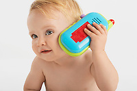 Baby Listening to Toy telephone
