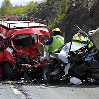 FILE PIC TO GO WITH DAVID CUNNINGHAM COURT CASE AT PERTH SHERIFF COURT.....<br />Police and Firefighters at the scene of a double fatal crash on the A9, 3 miles south of Drumochter, between a mini-bus from Glasgow and a Landrover<br /><br />see story by Gordon Currie Tel: 01738 446766<br /><br />Pic by Graeme Hart<br />Copyright Perthshire Picture Agency<br />Tel: 01738 623350 / 07990 594431