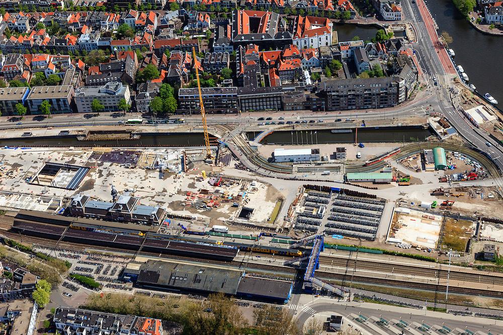 Nederland, Zuid-Holland, Delft, 09-05-2013; Spoorzone Delft, werkzaamheden aan de spoortunnel, omgeving station. Omdat het bestaande spoorviaduct met slechts twee sporen een flessenhals vorm wordt dit vervangen door een spoortunnel. Verder komt er een ondergronds station, onder het nieuwe stadskantoor..Spoorzone Delft. Because the existing railway viaduct - through the historical inner city - has only two tracks it is a bottleneck. A new underground railway tunnel is being build, it will include an underground station, under the new city hall..luchtfoto (toeslag op standard tarieven).aerial photo (additional fee required).copyright foto/photo Siebe Swart