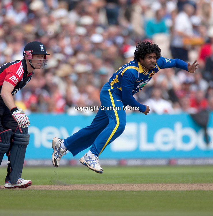 Lasith Malinga bowls past Eoin Morgan during the fifth and final one day international between England and Sri Lanka at Old Trafford, Manchester. Photo: Graham Morris (Tel: +44(0)20 8969 4192 Email: sales@cricketpix.com) 06/07/11