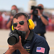 September 7, 2008 -- NAS BRUNSWICK, Maine. The Blue Angels photographer, Mass Communication Specialist 3rd Class Michael Carnicelli, captures the action at the The Great State of Maine Airshow on Sunday afternoon. The airshow visited Naval Air Station Brunswick for the last time this weekend, bringing The U.S. Navy Blue Angels, The U.S. Army Golden Knights and a wide variety of static displays and interactive exhibits. The show drew over 150,000 people over three days with no mishaps among the performers and no emergencies among the attendees. .Because NAS Brunswick is scheduled to be closed in 2011 by the Base Realignment Commission, there will not be another Navy-sponsored airshow at this location. Yet, the Local Redevelopment Authority, responsible for managing the property after the departure of the Navy,  has included an airshow on a list of possible future uses for the property.  U.S. Navy Photo by Mass Communication Specialist 1st Class Roger S. Duncan (RELEASED)