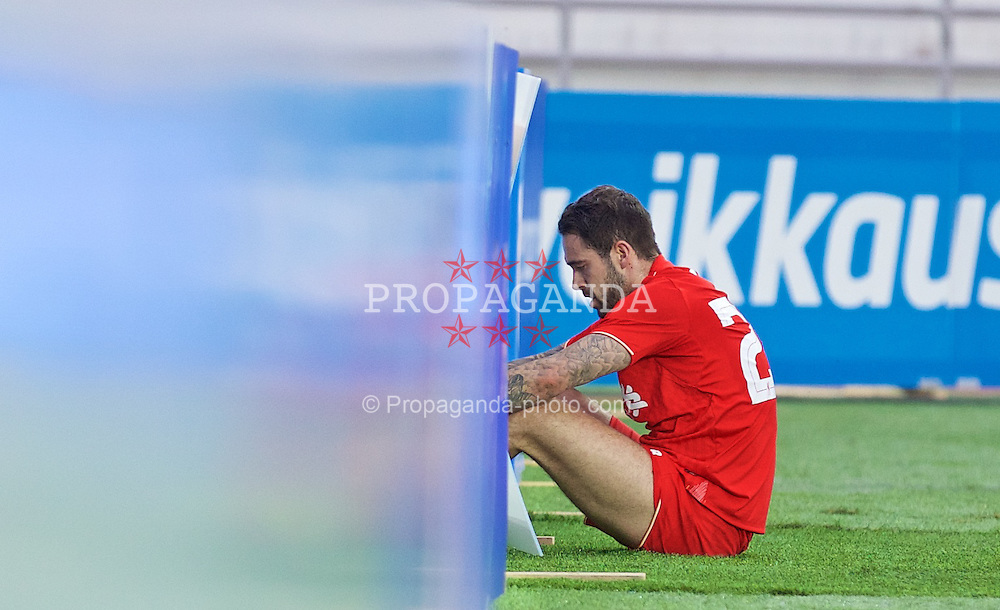 HELSINKI, FINLAND - Friday, July 31, 2015: Liverpool's Danny Ings crashes into the advertising hoardings during a friendly match against HJK Helsinki at the Olympic Stadium. (Pic by David Rawcliffe/Propaganda)