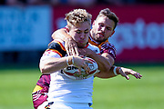 Bradford Bulls hooker Sam Hallas (29) grabs the ball and tries to get away but is stopped during the Kingstone Press Championship match between Batley Bulldogs and Bradford Bulls at the Fox's Biscuits Stadium, Batley, United Kingdom on 16 July 2017. Photo by Simon Davies.