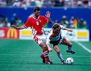 FIFA World Cup - USA 1994<br /> 10.7.1994, Giants Stadium, New York/New Jersey.<br /> World Cup Quarter Final, Bulgaria v Germany.<br /> Hristo Stoitchkov (Bulgaria) v Thomas Häßler (Germany).