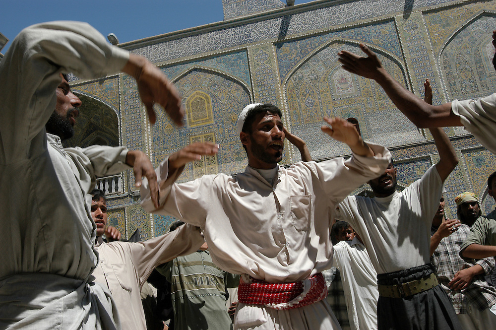 Shiite pilgrims sing and beat their chests in the shrine of the Imam Ali mosque in the holy city of Najaf on the anniversary of the death of the Prophet Mohammed..Najaf, Iraq. 01 May 2003..Photo © J.B. Russell