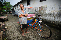 Bapak Sibali with his becak sepeda at the Jongaya leprosy settlement, Makassar, Sulawesi, Indonesia. Bapak Sibali, 49, is originally from Takalar, Sulawesi.  He found out he had leprosy in 1972 but stayed with his family until 1978, when he moved to Jongaya.  He met his wife, who also has leprosy, at the settlement.  They have one child who is 5 years old.  Since 1999 he has worked as a tukang becak sepeda, pedalling customers all over Makassar.
