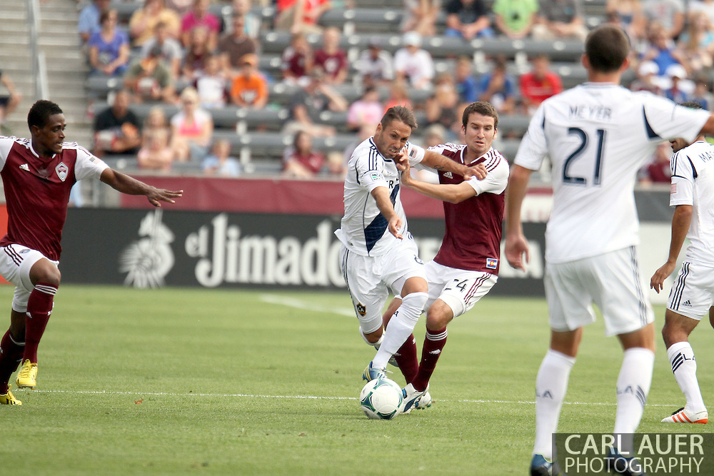 July 27th, 2013 - Colorado Rapids midfielder Nathan Sturgis (24) and LA Galaxy midfielder Marcelo Sarvas (8) fight for control of the ball in the first half of action in the Major League Soccer match between the LA Galaxy and the Colorado Rapids at Dick's Sporting Goods Park in Commerce City, CO