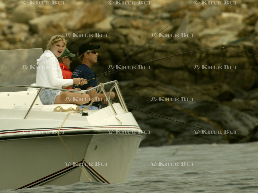Jenna Bush, left, yawns while fishing with her father President Bush during a fishing expedition near the family home Sunday, July 7, 2002, in Kennebunkport, Maine.  President Bush is spending the Independence Day weekend in Kennebunkport, Maine, home of his parents...Photo by Khue Bui