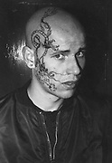 Skinhead with facial tattoo