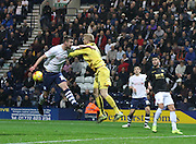 Paul Hungtington and Ben Amos collide during the Sky Bet Championship match between Preston North End and Bolton Wanderers at Deepdale, Preston, England on 31 October 2015. Photo by Pete Burns.