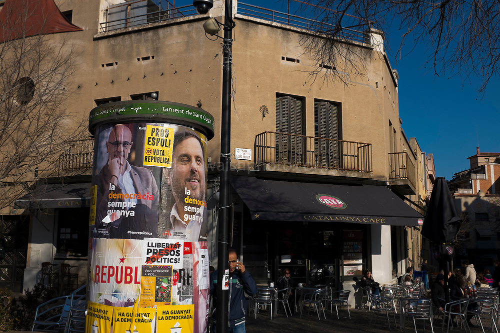 Sant Cugat del Valles - Election posters featuring local resident and Catalan foreign minister Raul Romeva, and also vice-president Oriol Junqueras, jailed following the October 1st referendum.<br /> <br /> Posters for Catalan Regional Elections, December 2017, called by Spanish Primer Minister Rajoy following the October 1st referendum on independence, and the application of Article 155 of the Spanish constitution - an attempy by Spain to maintain its unity. While right wing anti-independence party Ciudadanos won the election, they didn't get a majority - a coalition of pro-independence parties instead restored the exiled Carles Puigdemont to the Catalan presidency.