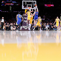 11 April 2014: Golden State Warriors forward David Lee (10) goes for the skyhook over Los Angeles Lakers forward Ryan Kelly (4) and Los Angeles Lakers forward Wesley Johnson (11) during the Golden State Warriors 112-95 victory over the Los Angeles Lakers at the Staples Center, Los Angeles, California, USA.