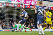 Southend United goalkeeper Mark Oxley (1) saving from AFC Wimbledon midfielder Anthony Wordsworth (40) during the EFL Sky Bet League 1 match between Southend United and AFC Wimbledon at Roots Hall, Southend, England on 16 March 2019.
