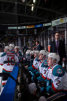KELOWNA, CANADA - JANUARY 9: Lassi Thomson #2, Dalton Gally #3 and Libor Zabransky #7 of the Kelowna Rockets sit on the bench and watch the replay on the jumbotron against the Everett Silvertips on January 9, 2019 at Prospera Place in Kelowna, British Columbia, Canada.  (Photo by Marissa Baecker/Shoot the Breeze)
