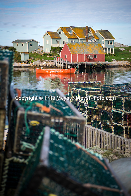 """Peggy's Cove, Nova Scotia, Canada, August 2014. <br /> Peggy's Point Lighthouse, known to many as Peggy's Cove Lighthouse is located in the quaint fishing village of Peggy's Cove. Peggy's Cove is famed for its picturesque and typically East-Coast profile, with houses perched along a narrow inlet and on wave-washed boulders facing the Atlantic. Although this unique environment has been designated a preservation area, it is still an active fishing community. Nova Scotia was one of the original four provinces that became part of Canada in 1867.  """"Nova Scotia"""" is Latin for """"New Scotland"""", and Scottish settlers brought culture and traditions that continue to this day. Photo by Frits Meyst / MeystPhoto.com"""