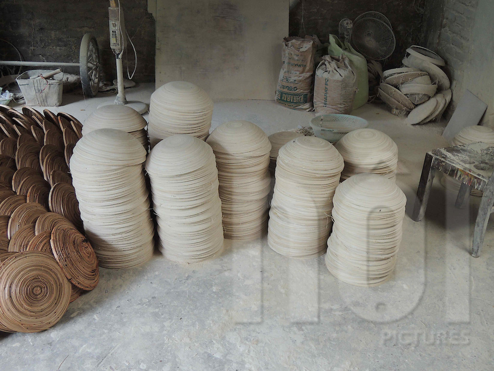 Stacked bamboo bowls left in a workshop in Cat Dang, Vietnam, Southeast Asia