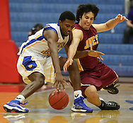 Vincennes' Willie Wiley and Jones County's Johnny Zuppardo dive aftera loose ball in the first half of the semifinal game of the NJCAA tournament Friday, Mar. 21, 2014 at the Sports Arena.