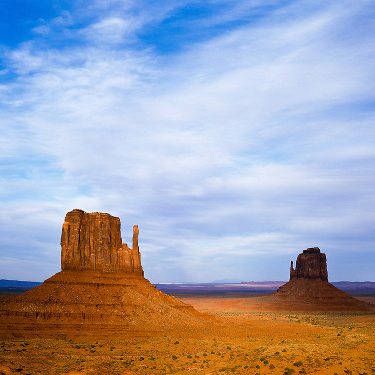 A cloud bank hovers near the most iconic view of the american southwest: the Mitten Buttes, in Monument Valley Navajo Trbal Park