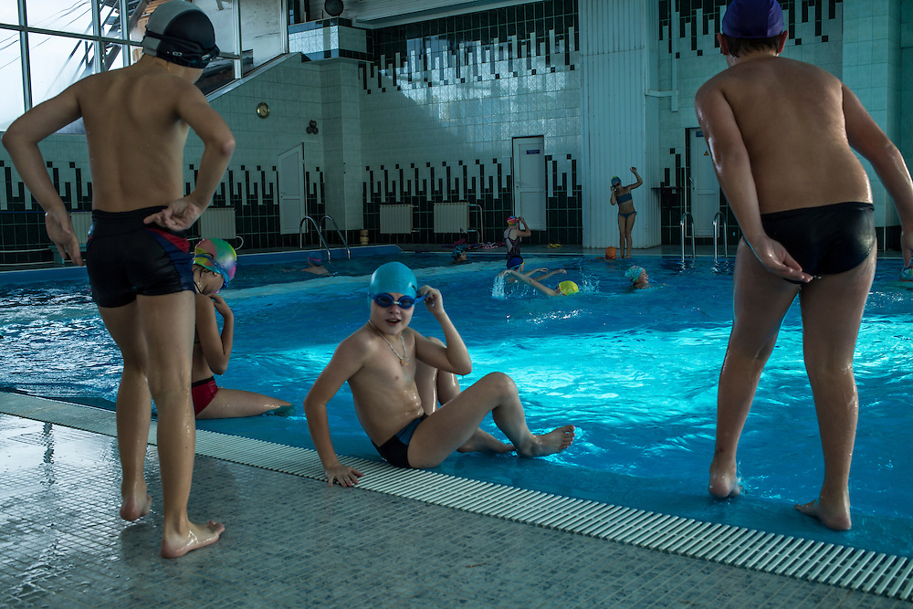 Children attend a swim class at the local sports complex on Thursday, October 24, 2013 in Baikalsk, Russia.