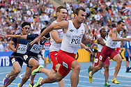 (L) Karol Zalewski and (R) Kamil Krynski both from Poland compete in men's relay 4x100 meters qualification during the 14th IAAF World Athletics Championships at the Luzhniki stadium in Moscow on August 18, 2013.<br /> <br /> Russian Federation, Moscow, August 18, 2013<br /> <br /> Picture also available in RAW (NEF) or TIFF format on special request.<br /> <br /> For editorial use only. Any commercial or promotional use requires permission.<br /> <br /> Mandatory credit:<br /> Photo by © Adam Nurkiewicz / Mediasport