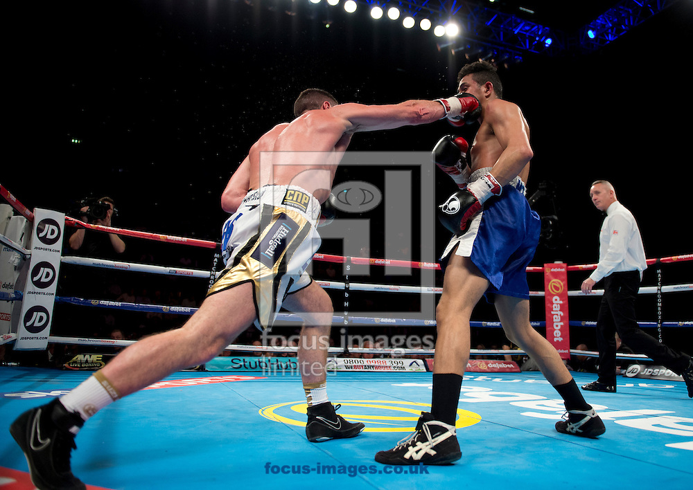 Tommy Coyle (white and gold shorts) v Reynaldo Mora (blue shorts) during their lightweight contest at Manchester Regional  Arena, Manchester<br /> Picture by Russell Hart/Focus Images Ltd 07791 688 420<br /> 07/05/2016