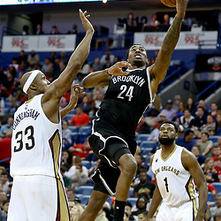 Jan 20, 2017; New Orleans, LA, USA; Brooklyn Nets forward Rondae Hollis-Jefferson (24) shoots over New Orleans Pelicans forward Dante Cunningham (33) during the second half of a game at the Smoothie King Center. The Nets defeated the Pelicans 143-114. Mandatory Credit: Derick E. Hingle-USA TODAY Sports