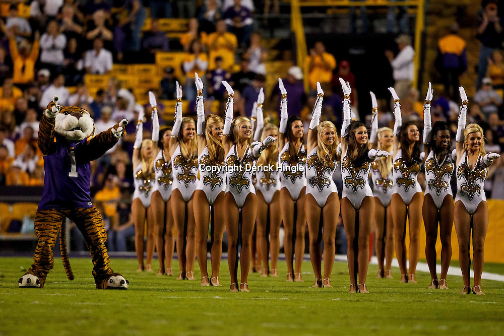 November 13, 2010; Baton Rouge, LA, USA; The LSU Tigers Golden Girls and mascot Mike the Tiger perform prior to kickoff of a game against the Louisiana Monroe Warhawks at Tiger Stadium.  Mandatory Credit: Derick E. Hingle