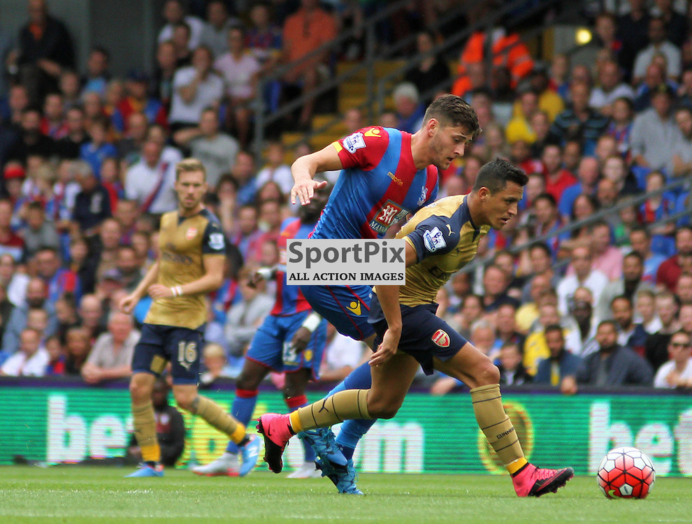 Joel Ward puts pressure on Alexis Sanchez of ArsenalDuring Crystal Palace vs Arsenal on Sunday the 16th August 2015.