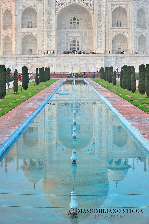 Reflections of Taj Mahal in fountain in front of the main gate..In 1631, Shah Jahan, emperor during the Mughal empire's period of greatest prosperity, was grief-stricken when his third wife, Mumtaz Mahal, died during the birth of their 14th child, Gauhara Begum.Construction of the Taj Mahal began in 1632. The court chronicles of Shah Jahan's grief illustrate the love story traditionally held as an inspiration for Taj Mahal. The principal mausoleum was completed in 1648 and the surrounding buildings and garden were finished five years later.