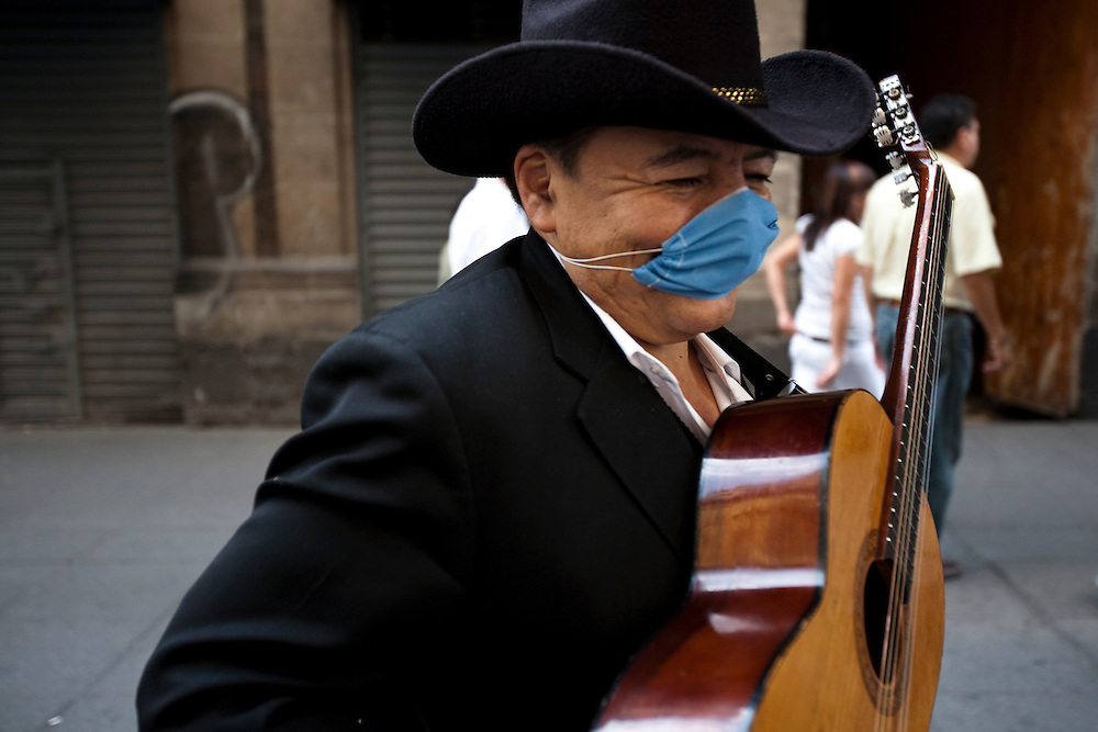 24 April 2009, Mexico City, Mexico--- A Mariachi wears a surgical mask to protect himself from a deadly strain of Swine Flu that has alread killed 60 people and made 1008 sick. The Swine Flu which has also been found elsewhere in Mexico and the USA is extremely worrying to the WHO, and CDC who belive that it could cause a Flu Pandemic. The disease tends to kill young healthy people, which is common with a Pandemic Flu.  --- Image by © Trevor Snapp
