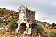 A Lycian sarcophagus tomb at the acropolis at Sydima, a Lycian site at Dorduga village, Fethiye, Antalya, Turkey. The ruins here date from the earliest classical Lycian period around the 5th century BC, although many of the remaining structures are Roman. Picture by Manuel Cohen