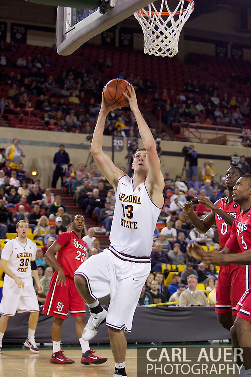 November 27th, 2010:  Anchorage, Alaska - Arizona State's Jordan Bachynski (13) goes to the hoop strong for a two handed dunk in the Sun Devil's 58-67 loss to St. Johns in the championship game of the Great Alaska Shootout.