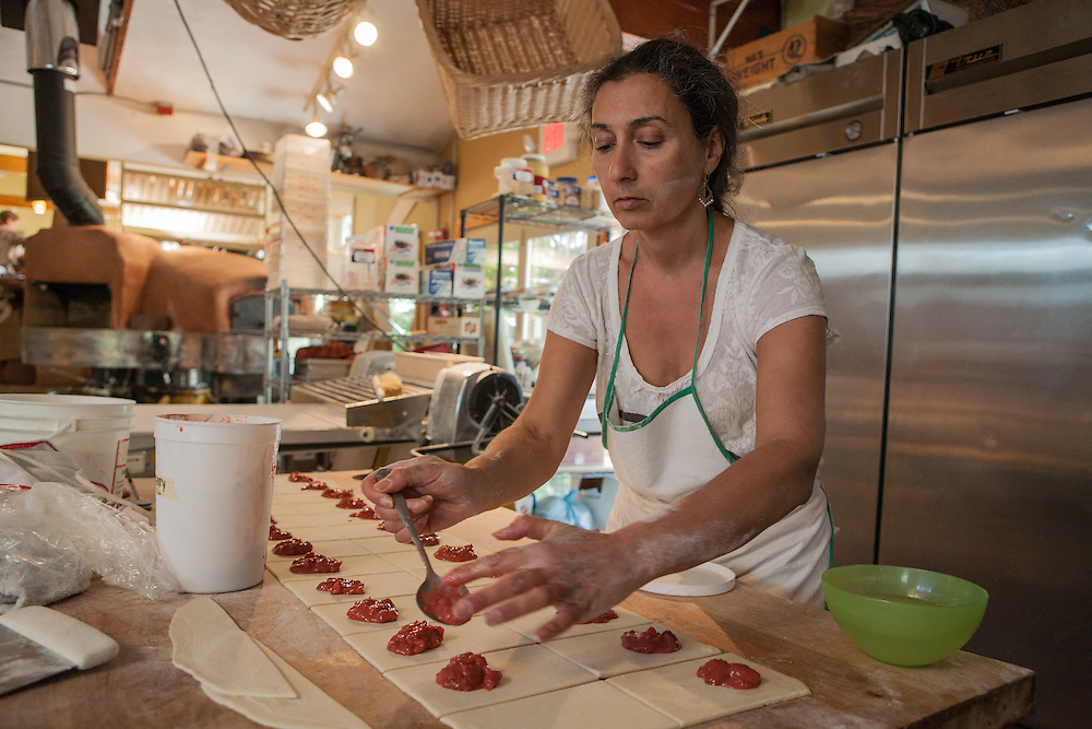 Jamestown, RI - 7 May 2007. Dorianna Carella, co-owner of The Village Hearth Bakery and Cafe, filling pastry.