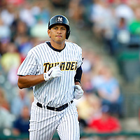 New York Yankees Third Baseman Alex Rodriguez runs towards first base during a minor league game for the AA Trenton Thunder in Trenton, NJ on August 3, 2013.  He is facing a suspension by Major League Baseball for his alleged use of steroids with the Biogenesis clinic in Florida.