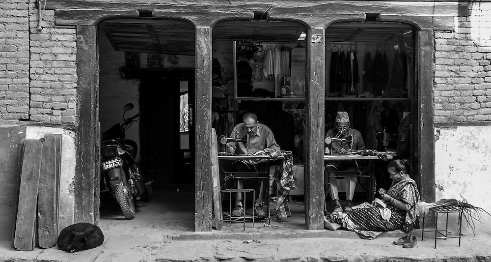 Two tailors and a Seamstress working in the afternoon sun in Tansen, Nepal