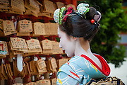 Geisha visiting Heian Shrine in Kyoto (Japan).