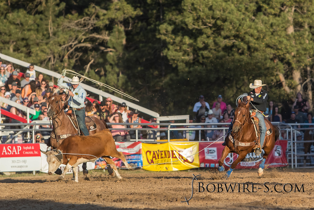 Header Trent Barrett and heeler Clay Adams make their team roping run during the second performance of the Elizabeth Stampede on Saturday, June 2, 2018.