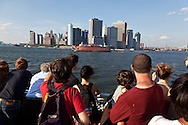 New York  on the ferry boat going to  governor island; in the heart of New York Harbor.  For almost two centuries, Governors Island was a military base - home to the US Army and Coast Guard; The 172-acre Island, 52 landmarked buildings  / sur le ferry boat qui dessert governor island , au centre du port de new York , pendant 200 ans cette ile a été occupee par l armee, aujourd'hui elle appartient a la ville qui en a fait unparc public