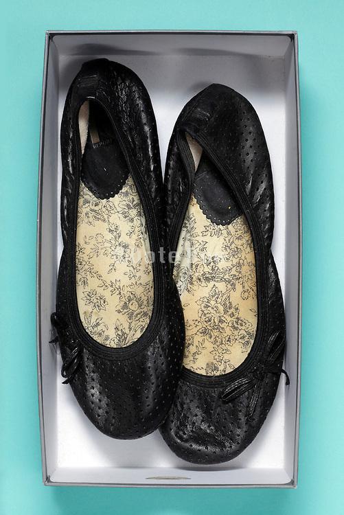 female sandals in a shoe box
