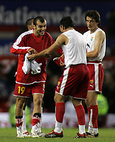 Photo: Paul Thomas.<br /> England v Macedonia. UEFA European Championships 2008 Qualifying. 07/10/2006.<br /> <br /> Goran Pandev (19) and his Macedonia team celebrate their draw with England.