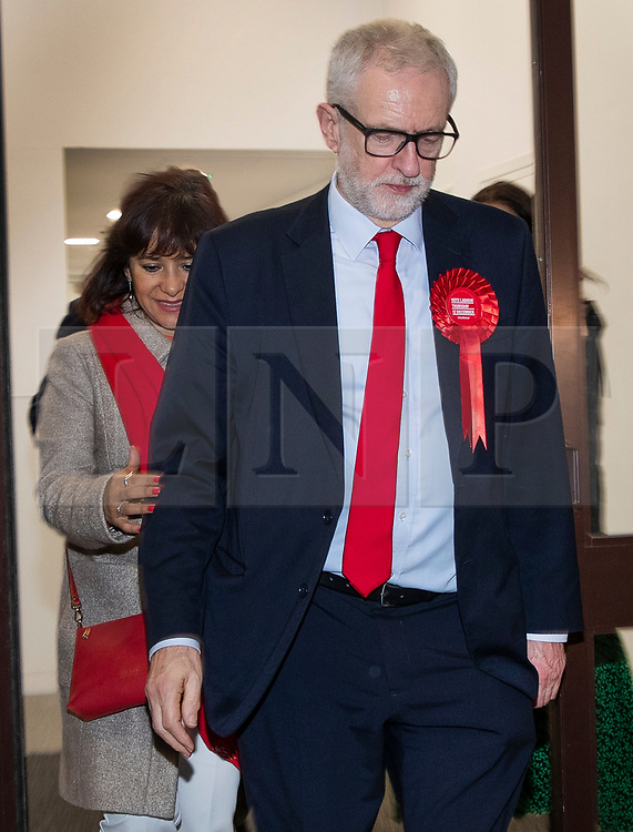 © Licensed to London News Pictures. 13/12/2019. London, UK. Labour Party Leader Jeremy Corbyn leaves party headquarters by the back door with his wife Laura Alvarez after the 2019 General Election results showed a majority for the Conservative Party.The Conservatives are predicted to win the election with a majority of 64 seats. Photo credit: Peter Macdiarmid/LNP