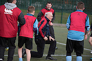 &copy; Licensed to London News Pictures. 02/02/2015. Twickenham, UK. VINCE CABLE TAKES A TUMBLE - he was unhurt and laughed it off with the children present.  The British Deputy Prime Minister, Nick Clegg and the Secretary of State for Business, Innovation and Skills, Vince Cable take part in the All Schools training session at Twickenham Academy, Today 2nd February 2015.<br /> <br /> Deputy Prime Minister Nick Clegg, and the Secretary of State for Business, Innovation and Skills, Vince Cable, visit Twickenham on Monday 2 February in support of the biggest year in history for English rugby . The visit comes just days before England's first Six Nations clash against Wales and ahead of the World Cup, which will support 12,000 jobs and contribute &pound;2.2 billion to the UK economy, as well as creating a lasting legacy for rugby in this country.. Photo credit : Stephen Simpson/LNP