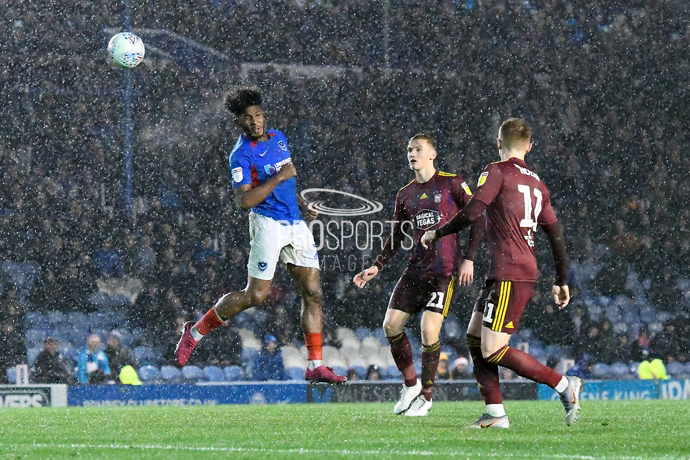 Ellis Harrison (22) of Portsmouth heads the ball during the EFL Sky Bet League 1 match between Portsmouth and Ipswich Town at Fratton Park, Portsmouth, England on 21 December 2019.