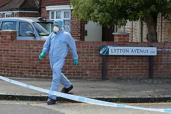 © Licensed to London News Pictures. 17/07/2020. London, UK. A forensic officer on Lytton Avenue, Enfield, in north London as police launch a murder investigation following the death of a man in his 30s. Police were called at 04:45hrs early this morning, to a report of four men fighting in Lytton Avenue, Enfield and a man being put into a vehicle. Later the victim died from a single stab wound in North Middlesex Hospital. Three men, no further details, have been arrested on suspicion of murder; all remain in custody. Photo credit: Dinendra Haria/LNP
